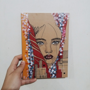 Hand-drawn illustration on a MUJI notebook